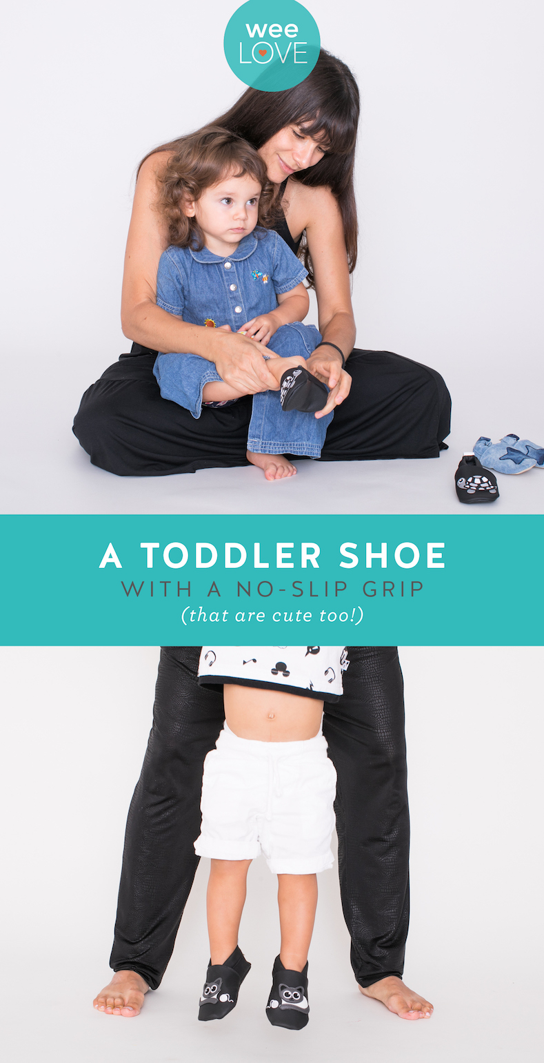 mom helping toddler put on baby nanya vegan shoes