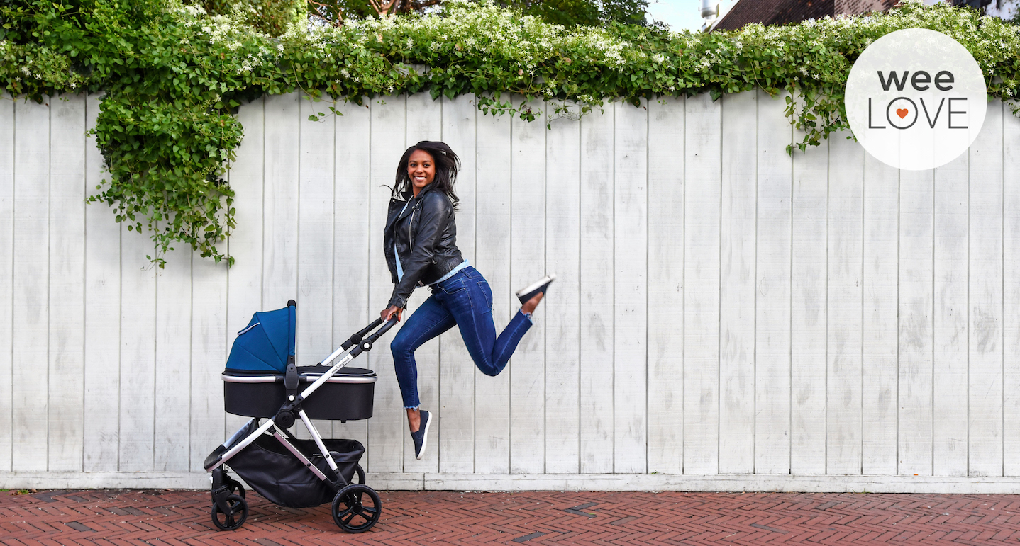 woman jumping next to mocking bird stroller