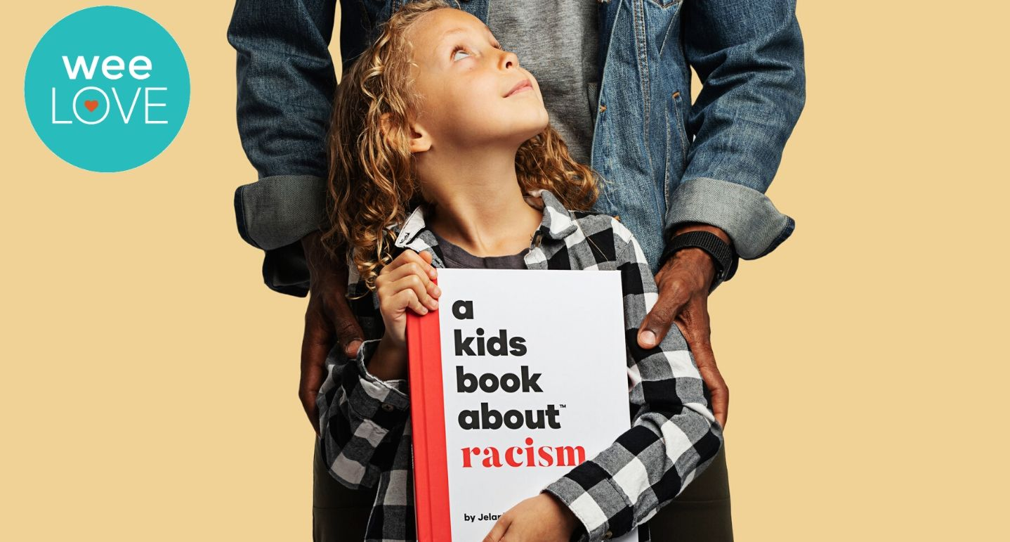 "a black man stands behind a young brown girl who's holding a book titled ""A Kids Book About Racism"""